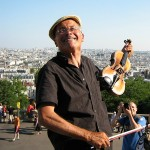 A happy violinist in Paris, France.