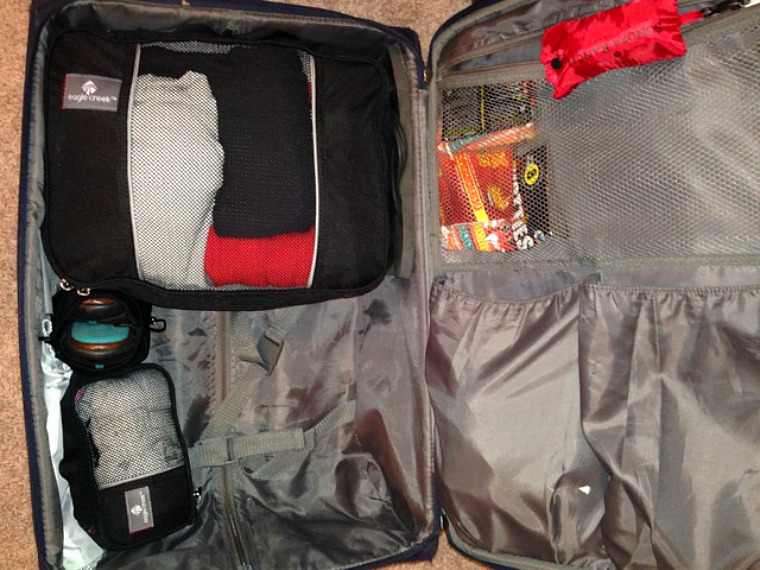 I managed to fit 3 weeks worth of clothes in this carry-on thanks to packing cubs- and still had room left over!