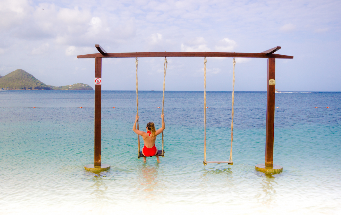 Swings over the water at Sandals Grande St. Lucian.